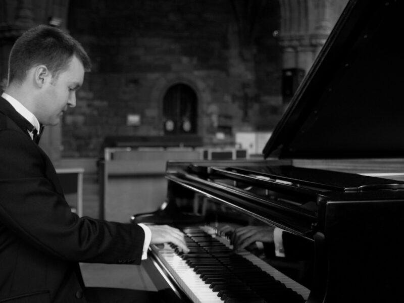 Robin Hutt playing piano bw