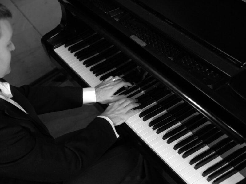 Robin Hutt playing piano keyboard bw